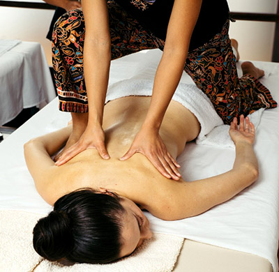 Our client receives soothing massages at our Oriental Massage Center in Madrid